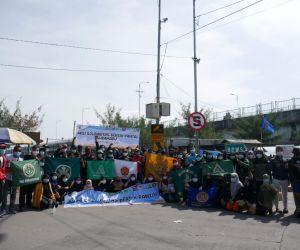 GP Ansor Kenjeran Gelar Aksi Bersih-Bersih Pantai Suramadu